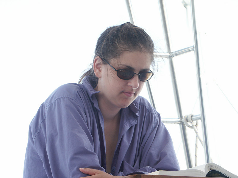 <b>Daphne reading while we sail</b>   (Jul 04, 2002, 03:40pm)