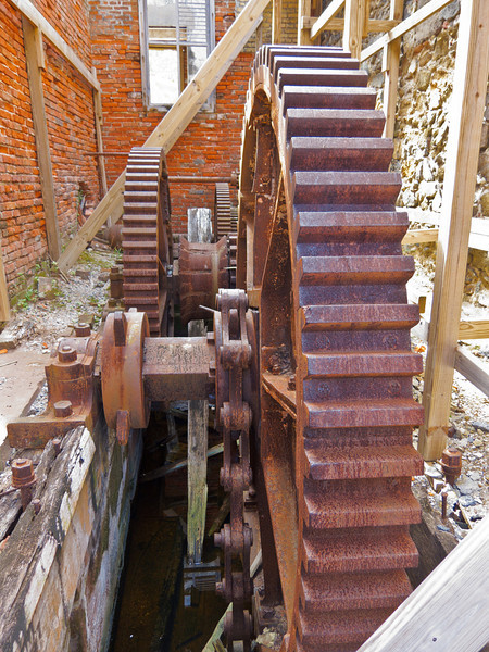 Giant gears at Creque Marine Railway, used to drag ships out of the water, into dry dock.  Hassel Island, St  Thomas