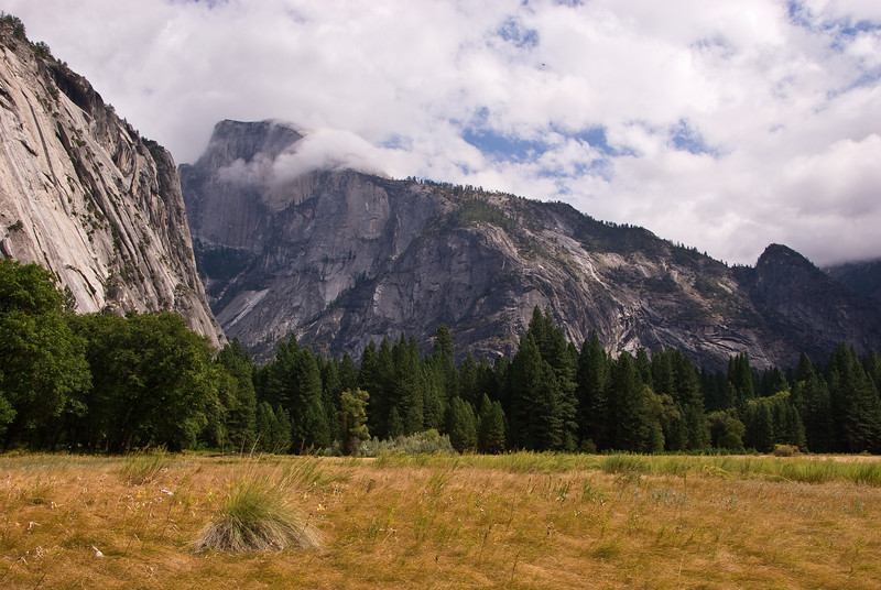 <b>Clouds wrapping around Half Dome</b>   (Sep 20, 2007, 12:35pm)  Seen behind meadows in Yosemite Valley