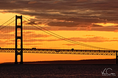 Trucks crossing the Mackinac Bridge at Sunrise