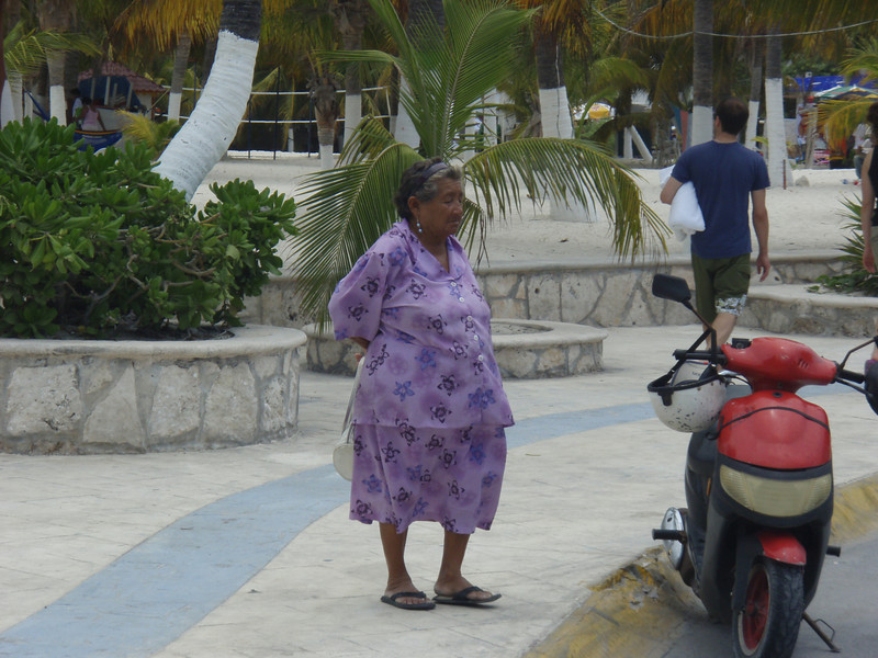 Local Mexican Lady waiting for the bus