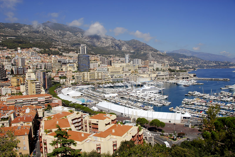 A view of the Port of Monaco as you look north towards Monte Carlo. There's no getting around it. The Principality of Monaco is all about money - making it, spending it and flaunting it. A short stroll along the harbour, where some of the world's most expensive and most luxurious yachts are moored will have your eyes popping out of their sockets at the shameless, unadulterated wealth on display.<br /> <br /> Information taken from Lonely Planet Guide.