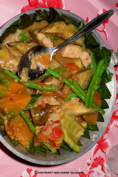 "This dish is like the Ilocos region's ""Pinakbet"". It is a mix of vegetables with pork, shrimp paste but cooked with heavy mix of coconut milk. It is served over banana leaves."