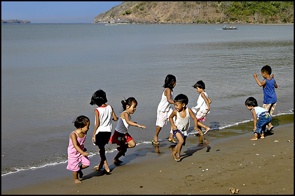 The children playing with the waves. It is so much fun watching them!