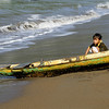 The young boy Nilo, tired but hopefull that one day he can paddle through the wave by himself.