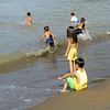 When the sun came out in the morning, the local children are out on the beach to play.