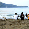 The people of Calayo, early morning just sits and talks while looking out to sea.