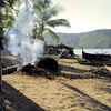 Early morning as I stroll the beach, they were burning beach debris on one side, while some people were gathered in one of the village houses shed.