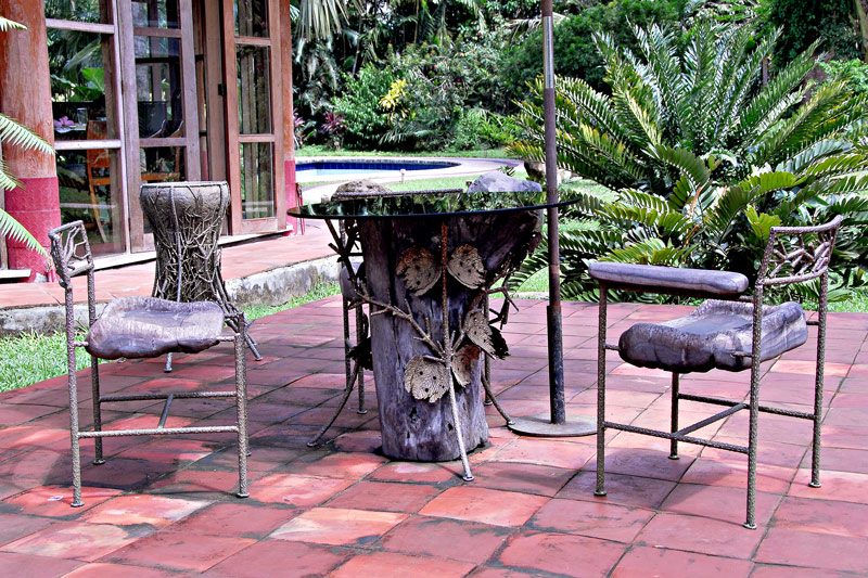 His workshop terrace is adorned with pieces of furniture he designed.