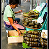 When I was in the Philippines, I stayed at my sister's home in Makati. Every weekend there is a farmers market at Jaime C. Velasques Park, Salcedo Village, Makati. At the farmer's market the city dwellers can buy very fresh produce from the neighboring provinces. This picture was taken when I went with my niece to the market. This lady is selling Suman (soo- mahn)or steamed, sweet, sticky rice. The rice is wrapped in banana leaves, tied with strings and steamed in clay pots. There different types, based on the type of rice used, the ingredients used to sweeten the Suman and the way the Suman is wrapped. Every province have their way of cooking a suman.Suman goes very well with the local hot chocolate drink or hot coffee.