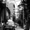 This is an example of the older streets in Makati. The streets are narrow and full of power lines, telephone lines, TV cables and other cables above. It has not been placed underground.
