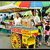 "After sampling a lot of food in the farmers market, you have to see the ""Sorbetero"" or the Ice Cream Man who sells ice cream (""Sorbetes"" in Pilipino language). I took thhis picture of the sorbetero before I bought and ice cream cone from him. He is more popular with the kids though, but I am still a kid at heart! So I will lick that ice cream on the cone like I used to do when I was in grade school."