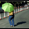 I took this picture on the way to the parking after doing my shopping at Makati farmer's market. I saw this bright green umbrella at the beginning of a long row of red and white traffic pylons. I hastily gabbed my camera and click the scene. In the Philippines people uses umbrellas even if it is not raining. It is to protect them from the searing heat of the sun. Sometimes, because it is already a habit, they open their umbrellas and use it even if there is no sun and rain.