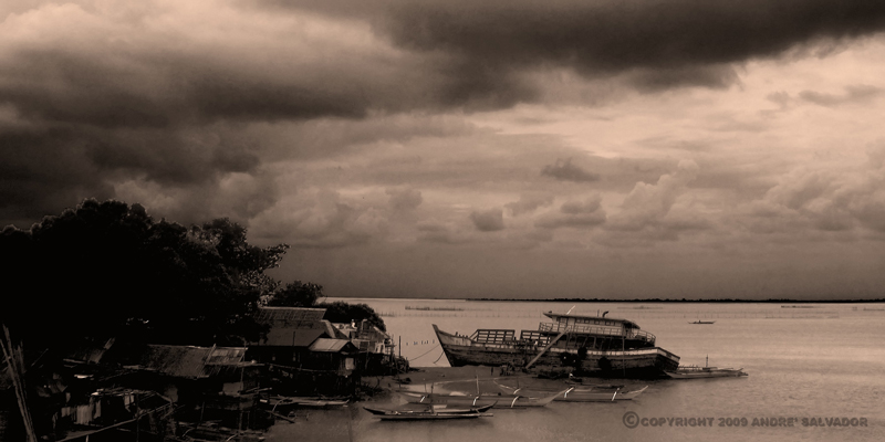 A small fishing village at the mouth of Monfort River by Guimaras Strait.