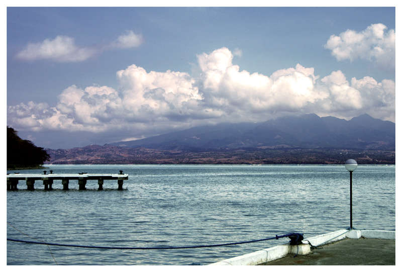 "<FONT size=""-1"">This is a view from Corregidor Island looking towards the Province of Bataan and an old damaged pier."