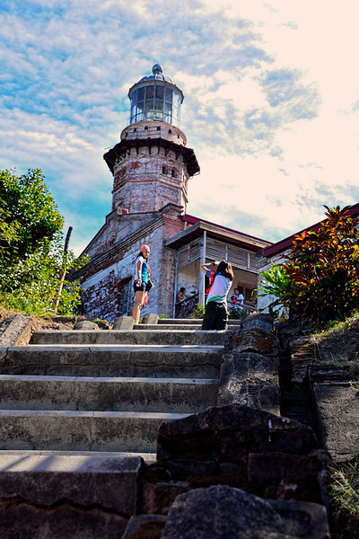 This is the Cape Bojeador or sometimes called Burgos lighthouse.<br /> <br /> The light marks the northwestern-most point in Luzon. The northeastern-most being Cape Engaño Lighthouse in Palaui Island, Santa Ana, Cagayan.<br />  <br /> The 66-foot-tall (20 m) octagonal stone tower, the most prominent structure in the vicinity, can be seen from as far away as Pasuquin town in the south and Bangui on the east on a clear day. Contrary to popular belief, it is not the highest-elevated nor tallest lighthouse in the Philippines. But the highest elevated still original and active Spanish era lighthouse in the country. Corregidor Lighthouse is higher at over 600 feet (180 m), and among the Spanish Colonial lighthouses, the tower of Cape Melville Lighthouse is the tallest at 90 feet (27 m). In Mindoro Strait, the recently erected modern tower at the Apo Reef Light Station rises to a height of 110 feet (34 m).