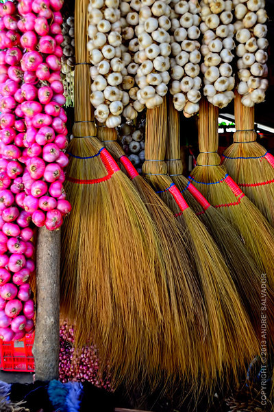 Red onions, garlics and brooms.