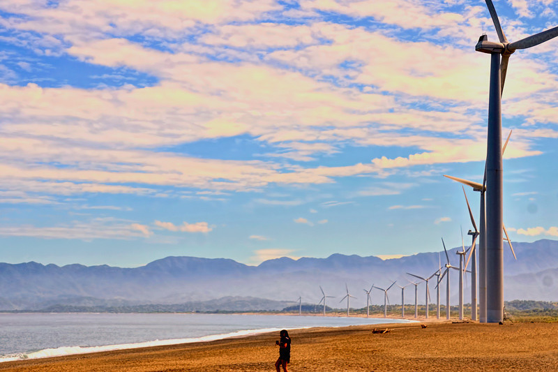 The location of the Philippines being near the Asia-Pacific monsoon belt is ideal for installing wind turbines. The Philippine Atmospheric, Geophysical and Astronomical Services Administration attests that the Philippines has a mean average of about 31 watts per square meter (W/m2) of wind power density