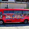 """Sagot ni Manang Imee Siribus"", a tourist bus picking up passengers at the airport."