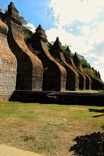 The side buttresses of the church.