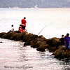 Another group of week-end fishermen, while the sun sets in the horizon.