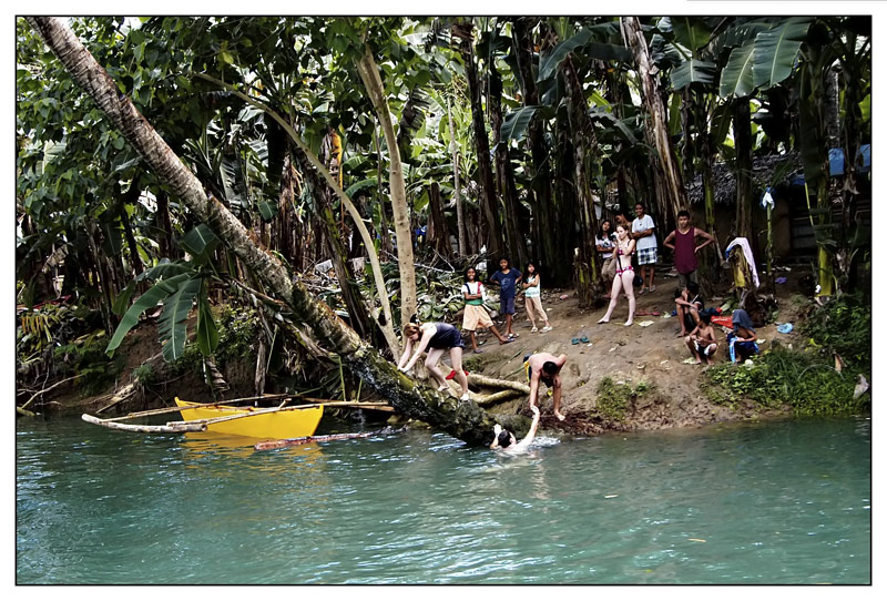 The tourists climb the coconut trees. At the top is a rope for them to swing into the water or just jump from the top. This is very popular to the teenage crowd.