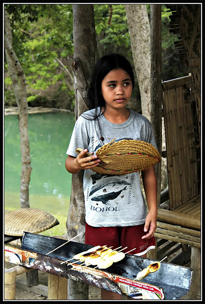 Lina, the 15 year old vendor is also grilling bananas like the girl in the store across from hers.