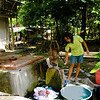 Here in Iloilo, most residences still use the deep well with manual pump for everyday domestic uses. Here a a labandera (laundry woman) is pumping water for use in her washing.