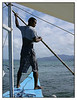I took a picture of this boatman as I leave Sabang Village on the way to the subterranean river at St. Paul's Bay. The boatman is young, about 25 years old, very dark skinned. He is always working under the bright sun and he is usually wet with sea water. Here he is trying to push the boat with a pole, away from the rocky bottom where the boat is moored. After taking this picture I placed my camera in the bag to protect it from the spray of sea water.