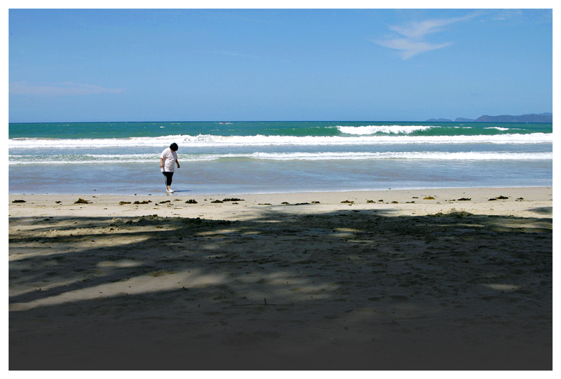 Sabang Beach - here Beth is enjoying walking the beach and picking up pretty shells.