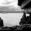A view of a vacation cottage and Guimaras Strait beyond.