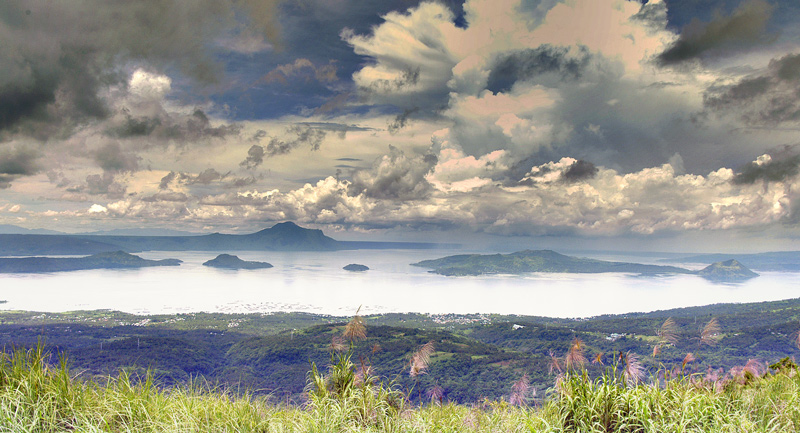 Taal Lake is located about 60 km southeast of Manila, the capital of the Philippines, on the main island Luzon. The fresh water lake is located within a complex volcanic caldera, one of the great volcano-tectonic depressions of the world. Its altitude is only 2.5 m and its surface measures 234.2 sq. km. 37 tributaries drain into the lake and its only outlet is Pansipit River which drains into Balayan Bay. Taal Lake is the third largest lake in the Philippines and is the second largest on the island of Luzon.