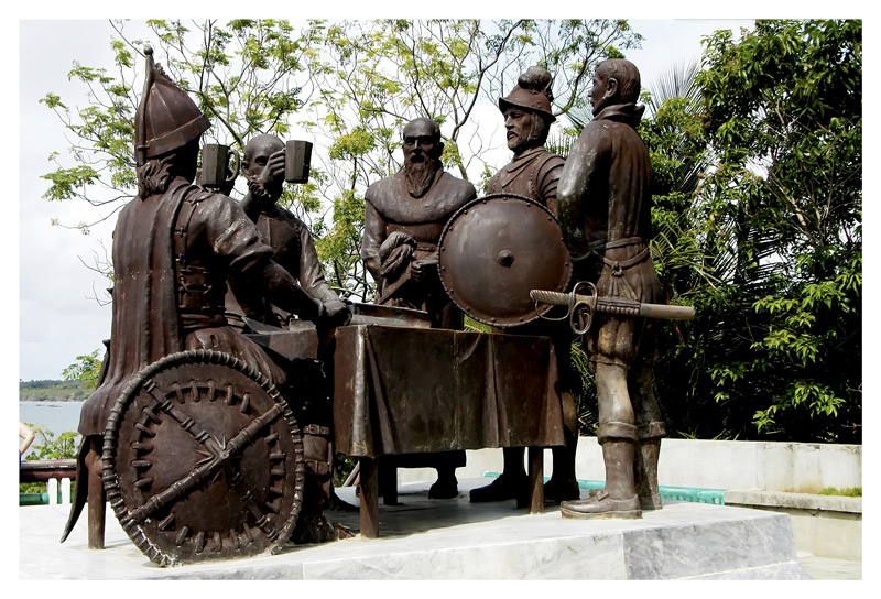 A monument to the blood compact between the Pilipino leader Sikatuna and the Spanish general.
