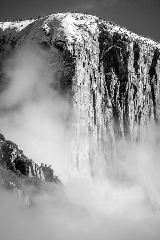 Fog, clinging to the face of El Capitan
