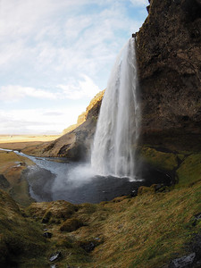 Seljalandsfoss waterfall. Olympus E-M1, 8mm fisheye 4/3 lens. F4, 1/400s, ISO 200. Another spectacular waterfall and one you can walk behind. This shot captured with the 4/3 8mm fisheye which had no problem exposing or focusing when used on the E-M1 (with adapter). So pleased to know that my 4/3 lenses are producing equally, if not better images with the E-M1.