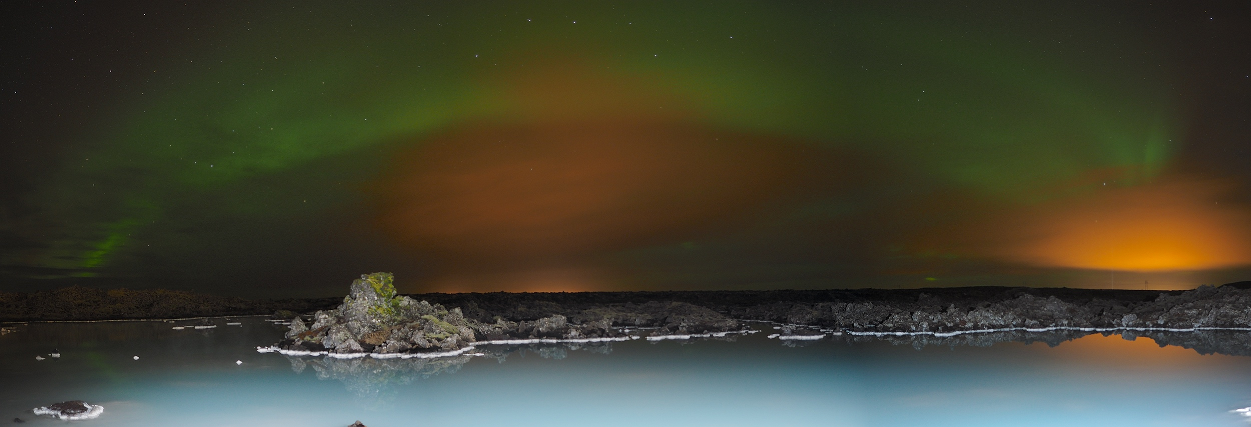 Aurora over Blue Lagoon Geothermal pools. Olympus E-M1, 12mm m4/3 lens. 3 exposures -F2, ISO 400,  13.6s/13.4s/9.8s