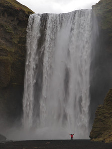 The mighty Skogafoss waterfall in south Iceland. Skógafoss is one of the biggest waterfalls in the country with a width of 25 metres (82 feet) and a drop of 60 m (200 ft). Get close and a good drenching beholds. Thats exactly what I did with the E5. We both got soaked. Great shot this to get a sense of scale...stick someone at the base :-)