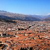 A panoramic shot of Cusco. The heart of the city Plaza de Armas is at center towards the left hand side with the churches.