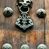 The door knocker at the church's main door.