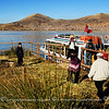 A view of the floating dock made of reeds and fellow Friendly Planet members getting on the boat.