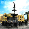 This bronze fountain was erected in 1650 at Plaza Armas.<br /> <br /> The Plaza Mayor or Plaza de Armas of Lima, is the birthplace of the city of Lima, as well as the core of the city. Located in the Historic Centre of Lima, it is surrounded by the Government Palace, Cathedral of Lima, Archbishop's Palace of Lima, the Municipal Palace, and the Club of the Union.