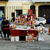A street scene - A vendor selling goods inside the grounds of St. Francis Church, Monastery and Catacombs, special priest privileges?