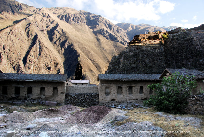 Restoration work is being done here. The Temple of the Sun is seen beyond. The village of Ollantaytambo is the best surviving example of Inca city planning. Much of it is built on Inca foundations.