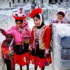 These are school children. Their costume looks like thay are all dressed up for a special occasion but they are not. The women and female children have about four layers of colorful clothing and each layer comes in different colors. The female always wear a colrful headgear. What surprizes me is that despite the cold the women are just wearng sandals!