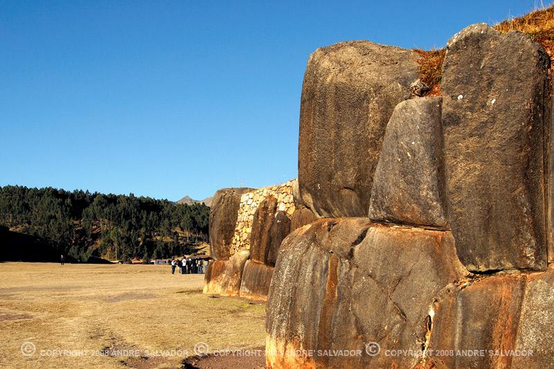 Massive stones act as retaining walls.