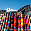 Cloths with Inca patterns add colors to the snow capped mountains.