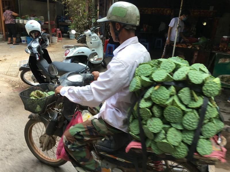 Lotus flower transport at Siem Reap