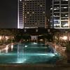 Raffles Hotel pool at night