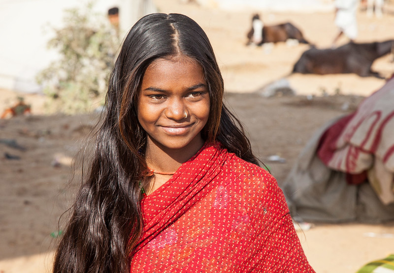 at the Pushkar Fair, a young girl (perhaps 9) of one of the vendor families