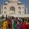 Local ladies pose before the Taj